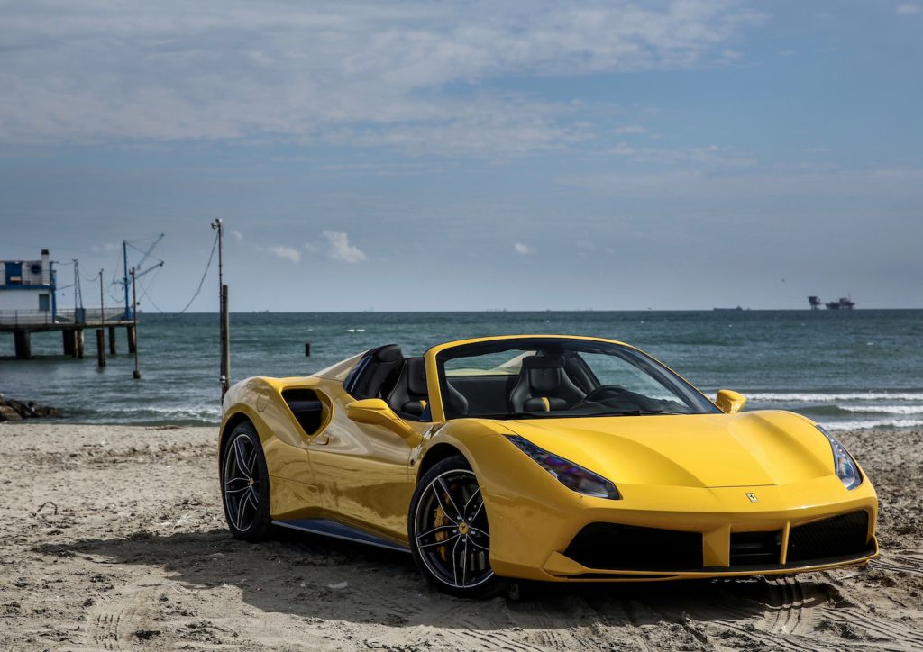 ferrari_488_spider_yellow_side_view_109183_3840x2400-1